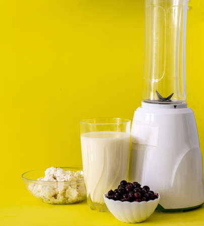 smoothie with cottage cheese and fresh berries on a solid yellow background