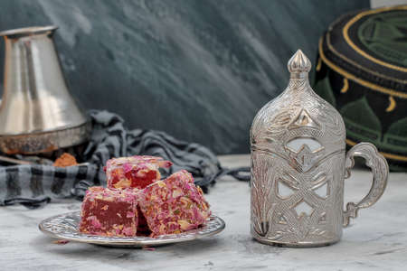 Oriental sweets Turkish delight and carved cup 写真素材