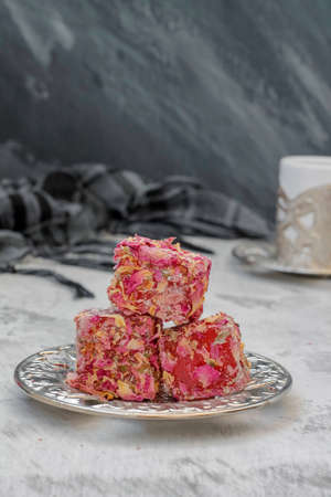 Oriental sweets Turkish delight and carved cup Reklamní fotografie