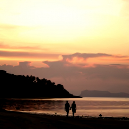 coastlines: Two young lovers walking on beach