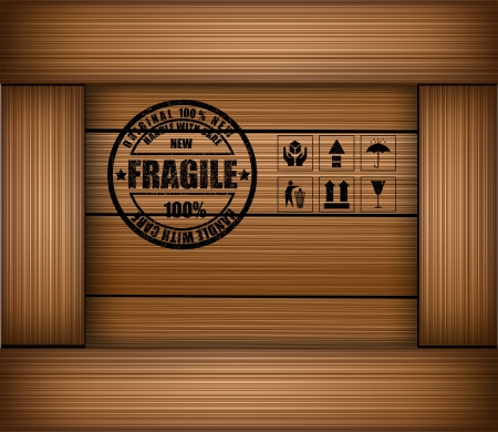 Safety fragile sticker icon on texture wooden box photo