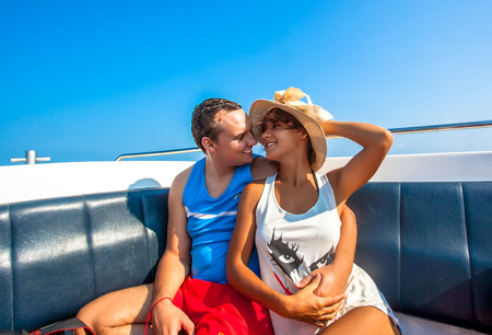 Couple in Love kissing on a sailing Boat in the Sea photo