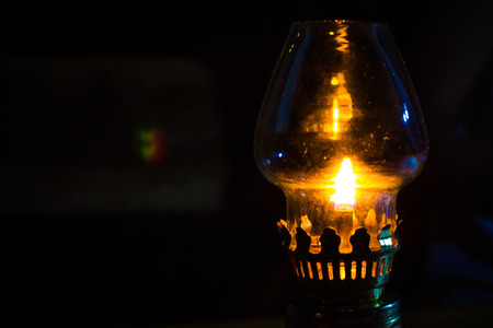 oil lamp in dark night. Photo macro photo
