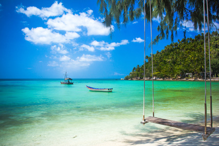 Swing hang from coconut tree over beach, Phangan island ,Thailand photo