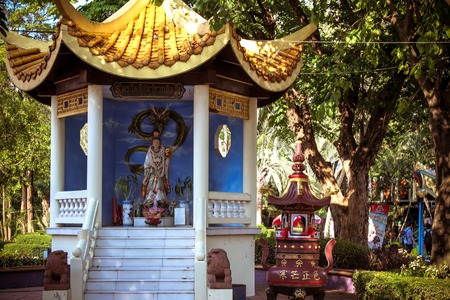 The traditional statue of buddha and colorful trees photo