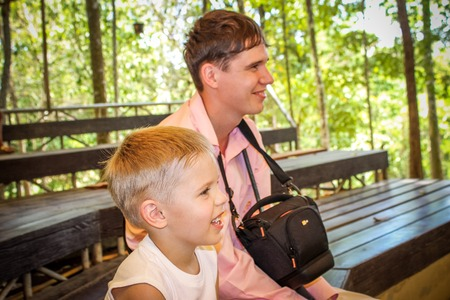 Dad and son watching the show in Koh Samui zoo photo