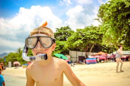 little boy on the beach in snorkeling mask. Koh Samui Thailand photo