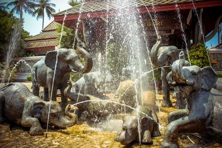 fountain of elephants statues in a garden, Koh Samui Thailand photo