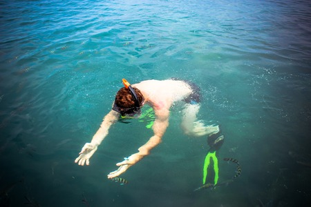 top view of a Man snorkeling in the sea photo