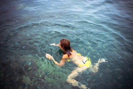 skin diving: Lady snorkeling in a transparent tropical sea Stock Photo