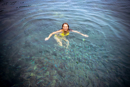 Lady snorkeling in a transparent tropical sea photo