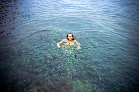 bikini top: Lady snorkeling in a transparent tropical sea Stock Photo
