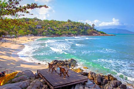 Two beach-chair beside the nice beach photo