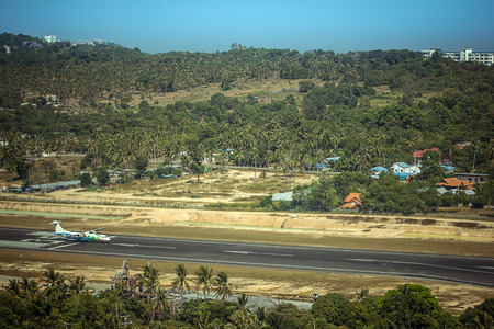 landing strip: landing strip of the airport with airplane in the island
