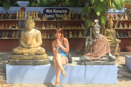 mummification: Woman sits at buddha statue in buddhist temples