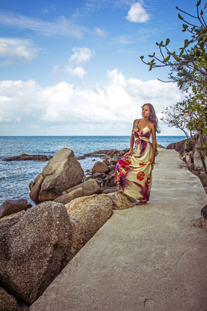 Woman standing on the path among stones in Samui Island photo