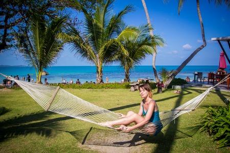 'koh samui': Woman sitting in hammock on Lamai Beach of Koh Samui, Thailand