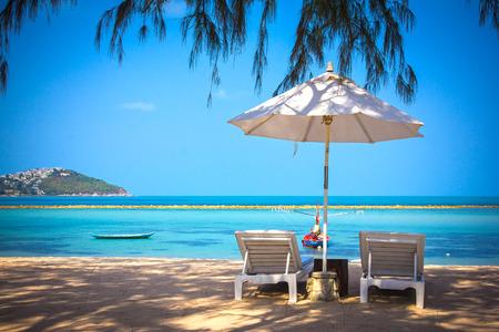 Sunbed and umbrella on a beautiful tropical beach photo
