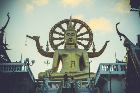 Samui big buddha gold statue on sky background in retro colors photo