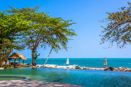Swimming pool near the beach at high class resort in Koh Samui photo
