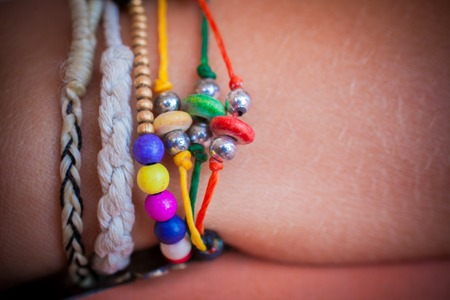 carbuncle: collection of bracelets on woman hand Stock Photo