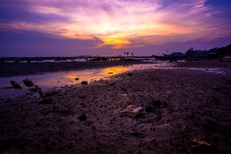 Violet sunset over the backwaters in Koh Samui, Thailand photo