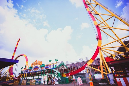 looping: Colorful Looping Roller Coaster On Beautiful Sunny Day in Moscow Editorial