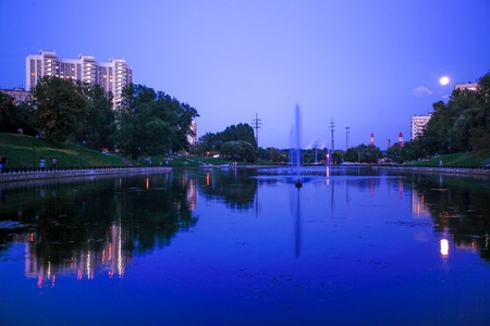 reflectivity: night town scene river and moon