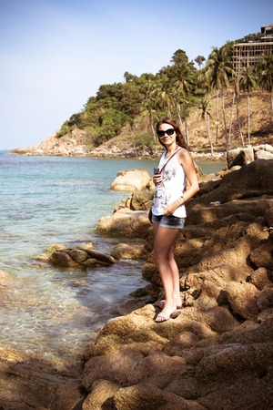 t short: Romantic beautiful woman sunbathing on a seaside. Koh Samui Stock Photo