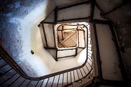 spiral stairway: Upside view of spiral stairway case in a lighthouse