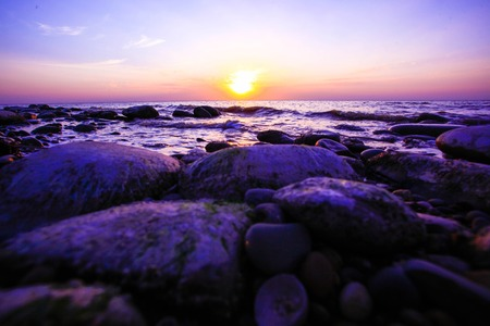 waves  pebble: Pebble beach with ocean waves on sunset.