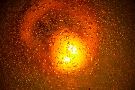 drop ceiling: Water drops on the embossed surface and light lamp Stock Photo