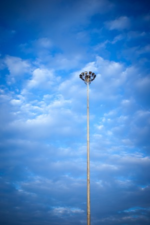 halogen: Street light with halogen lamp against blue sky and clouds Stock Photo