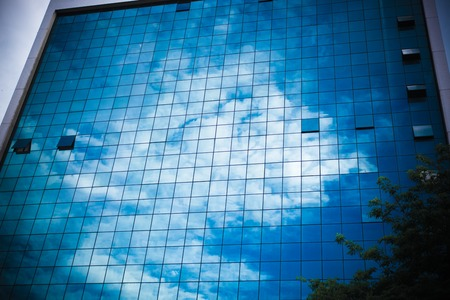 grid pattern: Building Reflection window glass with sky Stock Photo