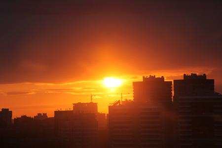 Beautiful Urban Sunset in cloudy weather