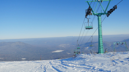 levi: Ski lifts on the bright winter day in mountains
