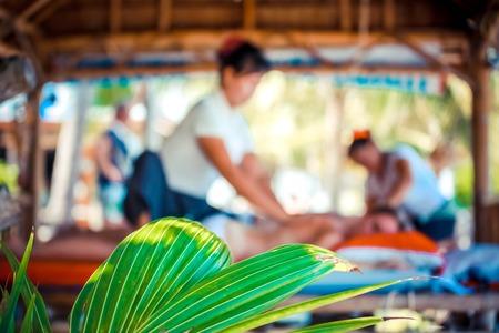 koh samui: Day in beach spa. Thai woman doing massage in Koh Samui. Thailand Stock Photo