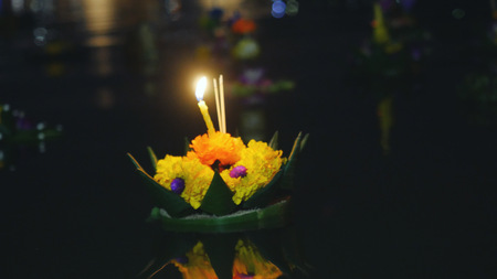 Loy Kratong Festival celebrated in Thailand. Launch boats from flowers and candles in a pond Stock Photo - 79200164