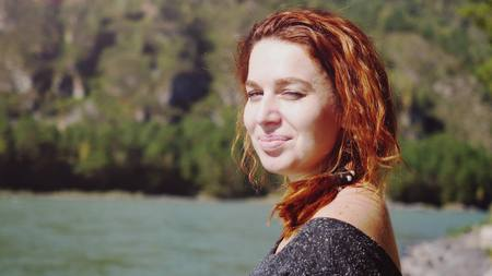 high def: Portrait of young beautiful happy woman with red curly hair