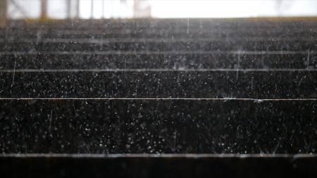 Heavy rain falling on a marble steps Stock Photo