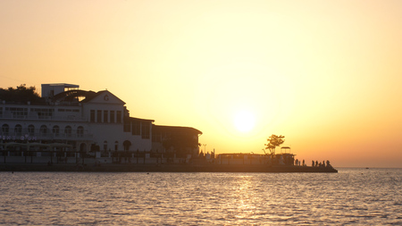 Russia, Crimea, 1 july 2017. Golden sunset over Beautiful coast with hotel.