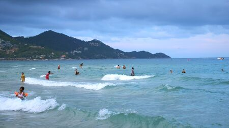 KOH Samui,THAILAND, APRIL 27, 2018. Chaweng beach. Unidentified people swimming in the sea. slow motion.