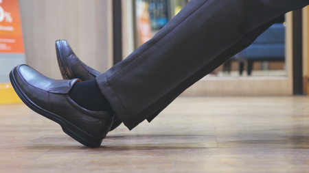 Close up of male feet in brown new fashion shoes. Businessman has shopping in shoes market.