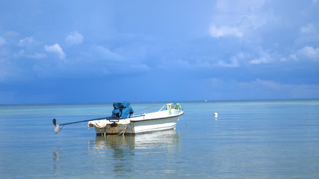Tropical Paradise at Koh Phangan. Sail boat in Lazure turquoise sea in cloudy day on beautiful sky on the background.