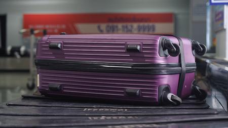 Airport baggage claim with luggage spinning around conveyor. Close up