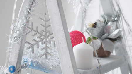 Decorated beautiful stepladder in the new year style. Christmas concept