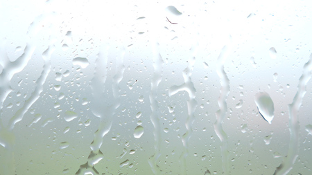 Heavy rain on window glass background