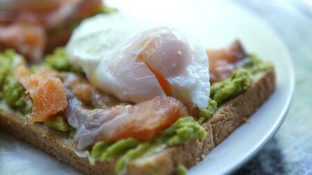 Tasty sandwich with Salmon Poached Egg Avocado. Gourmet Food. Gourmet Food