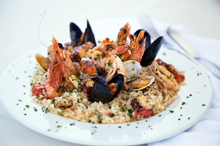 Italian risotto with shrimps, mussels, octopus, clams and tomatoes Stock Photo