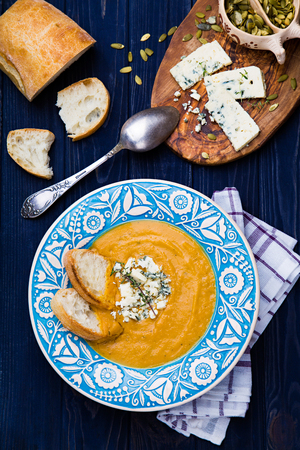 butternut: Creamy butternut squash soup with blue cheese, thyme and bread Stock Photo